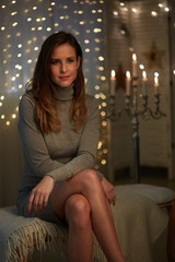Elegant young woman with christmas lights