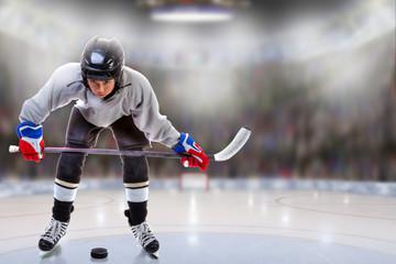 Junior Hockey Player Puck Handling in Arena