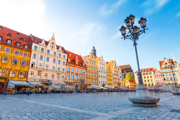 Fantastic view of the ancient homes on a sunny day. Location famous Market Square in Wroclaw, Poland, Europe. Historical capital of Silesia. Beauty world.