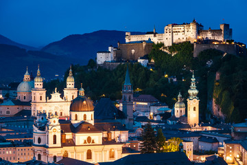 Fototapete - Great  view from the top on an evening city shining in the lights. Location famous place (unesco heritage) Festung Hohensalzburg, Salzburger Land, Austria Europe. Beauty world.