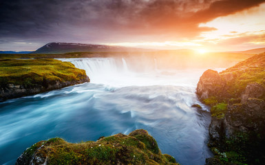 The rapid flow of water powerful Godafoss cascade. Location place Skjalfandafljot river, Iceland, Europe.