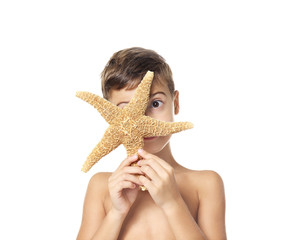 Cute little boy with starfish on white background