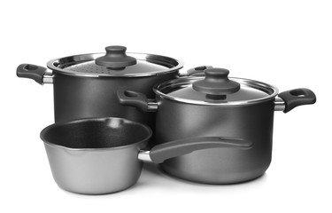 Saucepans on white background