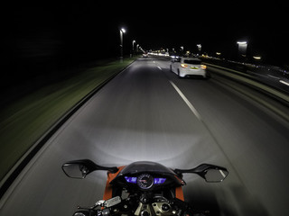 Motorcycle in motion after dark - a view from rider position / London, UK