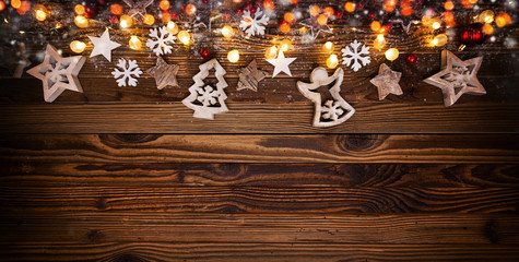 Christmas background with wooden decorations and spot lights.