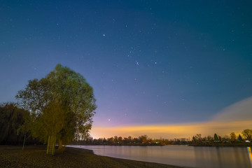 The Orion Constellation as seen from the shore of the river Rhine at Mannheim in Germany.