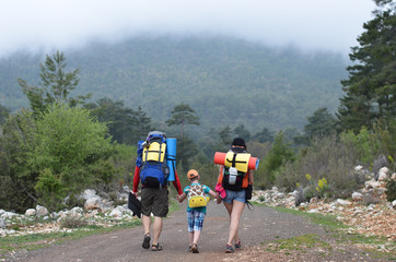 family backpackers in mountains