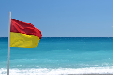 red yellow flag on the beach