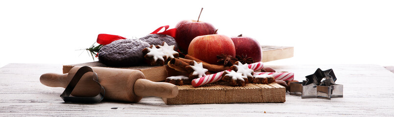 christmas cookies, apples, gingerbread and spice on white background