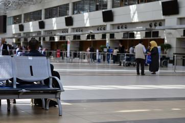 airport terminal in blur background
