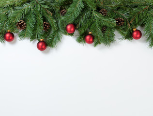 Christmas red ornaments hanging in fir tree branches