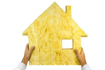 Glass wool with shape of house  in the craftsmans hands on white background