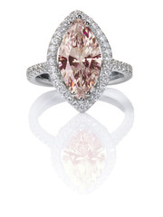 Peach Pink Morganite Beautiful Diamond Engagment ring. Gemstone Marquise cut surrounded by a halo of diamonds.