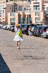 Woman on the city quay in Sete, France. Copy space for text. Vertical