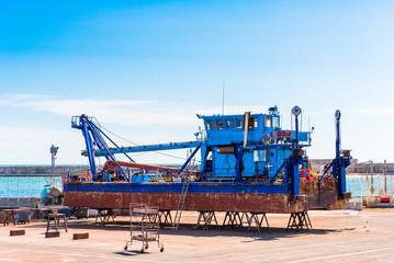 Ship loader on the shore. Ship repair in Sete, France. Copy space for text