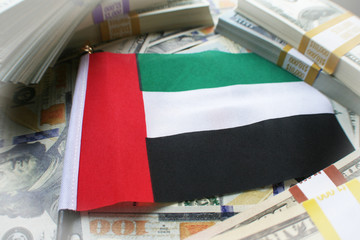 United Arab Emirates Flag ( Dubai Flag ) Surrounded With American Money ( Foreign Investments )