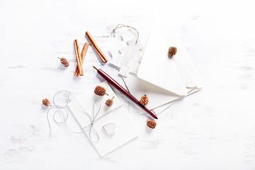 An Arrangement of Envelops, Letter Paper and Christmas Decorations
