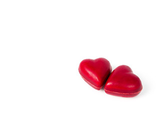 two heart shape chocolate candies
