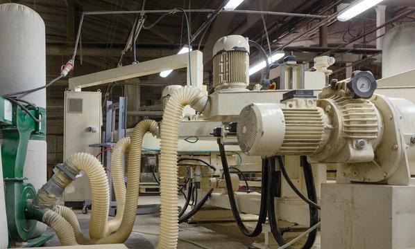 Wood processing machine in a furniture factory.