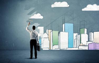 Salesman painting tall buildings on urban wall