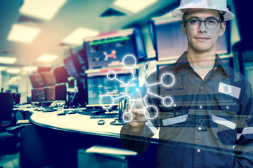 Double exposure of Engineer or Technician man with blank tool icons while pointing finger with monitor of computers room for oil and gas industrial business concept