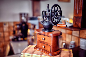 Espresso coffee with old coffee grinder .