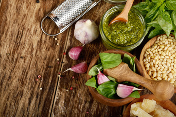 Top view of Pesto sauce ingredients and utensils on wood table