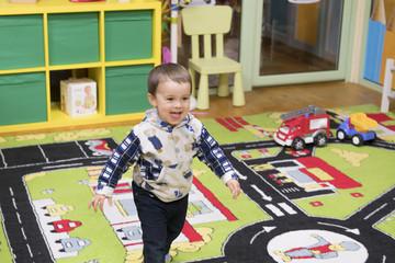 smiling baby boy in the children's room