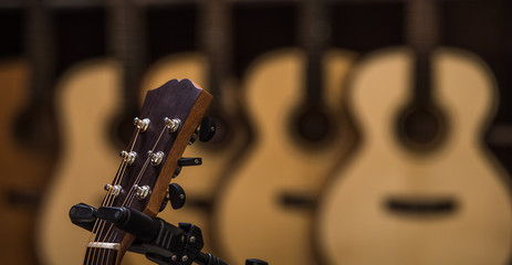 Acoustic classical guitars with strings in shop