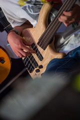 Musician playing a bass guitar in shop