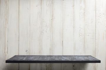 shelf at white wooden background