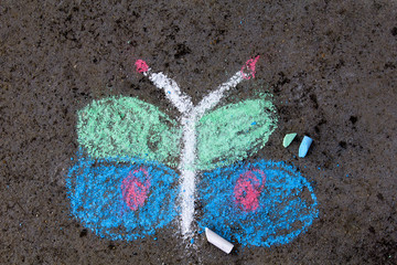 Colorful chalk drawing on asphalt: beautiful butterfly