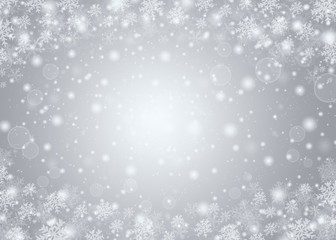 Christmas winter abstract background with snowflakes, bokeh lights and place for text. Christmas New Year's wallpaper