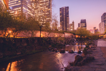 Seoul, South Korea cityscape at Cheonggye stream during twilight.
