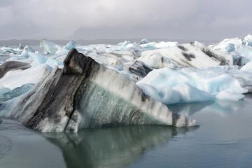 blue and white icebergs in a Jøkulsarlon glacier lake