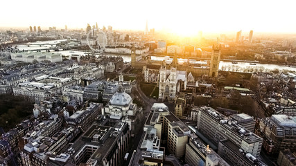 Panoramic Aerial View of Houses of Parliament Big Ben Icon in Central London features The London Eye Wheel, River Thames and Iconic Business Buildings Skyscrapers with Beautiful Sunrise 4K