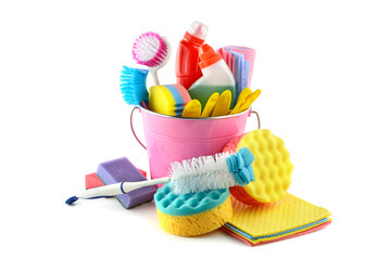 Set detergents in bucket (gloves, brushes, sponge, napkins) isolated on white