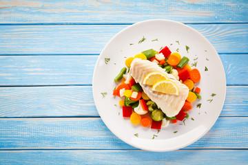 Printed kitchen splashbacks Fish Fish dish - fried fish fillet and vegetables