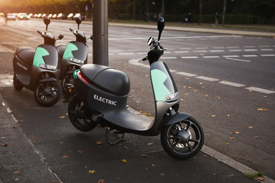 Electric scooter on a city street. Car sharing