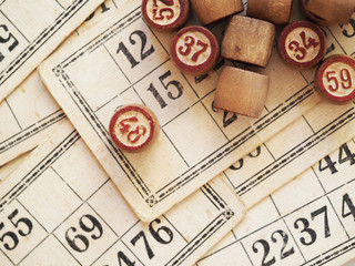 Tabletop old lotto game with wooden elements. Cards bingo.