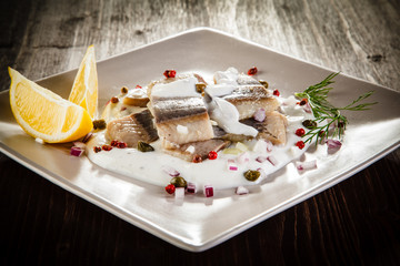 Marinated herring fillets in cream