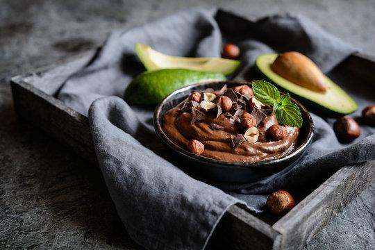Raw avocado chocolate mousse with hazelnuts