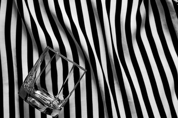 Abstract geometric black and white background with a glass of old fashioned