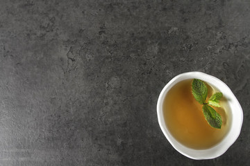 Fresh mint leaves in tea. Italian herbs. Dark background.
