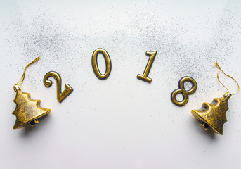 2018 new year background with glitter, sparkles, serpentine on white. Top view, close-up. Festive greeting card with copy spase.
