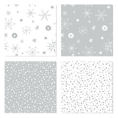 Seamless winter patterns. Set of Christmas backgrounds with hand drawn snowflakes. Holiday themed seamless patterns for wrapping paper, textile and wallpaper.