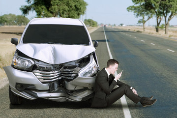 Caucasian person and damaged car