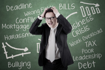 Businessman looks stressed with his problems