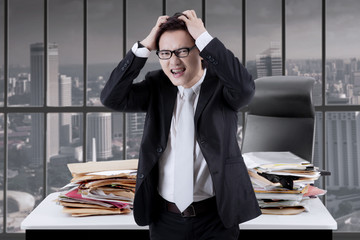 Asian businessman looks stressful in the office