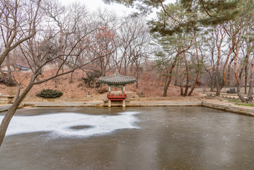 wooden pagodas in the park of seoul city in korea in winter